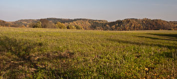 Autumn countryside panorama with meadows, forest and hills Stock Photography