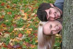 Autumn couple heads Stock Photos