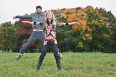 Autumn couple jump stock photography