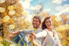 Couple. Autumn couple sitting grass smiling stock photography