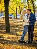 Autumn couple walking park. Friends walk outdoor. Royalty Free Stock Photos