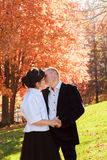 Autumn couple walking park and kissing. Autumn friends walk outdoor. Royalty Free Stock Image