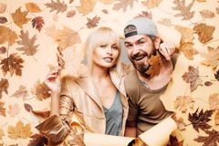 Autumn couple wearing in autumn clothes and looks very sensually. Funny fac . Autumn happy people and joy. Hello. November. Autumn sale or black friday stock photo
