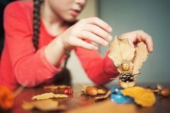 Autumn craft with kids. children`s cute boat with man made of natural materials. process of creating royalty free stock photo