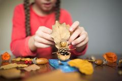 Free Autumn Craft With Kids. Children`s Cute Boat With Man Made Of Natural Materials. Process Of Creating Stock Photography - 153206452