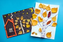 Autumn crafts. Children's fall crafts made from autumn dry yello stock images