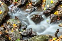 Autumn creek with a little cascade. Beautiful autumn creek with a little cascade Stock Photography