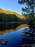 Autumn Creek Reflection. Trees reflecting on calm Creek in early Autumn Royalty Free Stock Photos