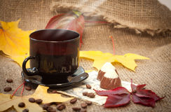 Autumn cup of coffee. And small chocolate   cookies Stock Photo