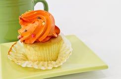 Autumn Cupcake with Orange Frosting Stock Photos