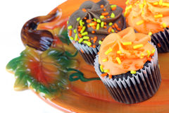 Autumn cupcakes on Pumpkin plate. Stock Photo