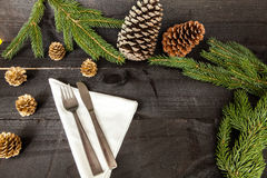 Autumn cutlery dinner decoration. Composition of cutlery on wood background for branches and a decorative dry oranges, pain fruit and leafs for informal dinners Stock Photo