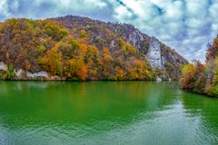 Autumn at the Danube Gorges and Decebal king Head sculpted in rock royalty free stock image