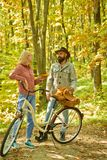 Autumn date hike in forest. Couple in love ride bicycle together in forest park. Romantic date with bicycle. Bearded man royalty free stock photos