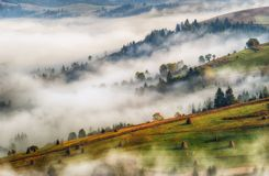 Autumn dawn. beautiful dawn in the Carpathian mountains. Foggy morning Royalty Free Stock Photography