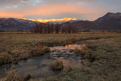 Autumn dawn in Heber Valley, Utah, USA. Autumn sunrise with a stream in farm fields, Heber Valley, Utah, USA Stock Photos