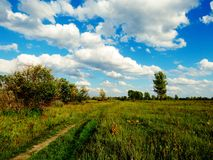 Autumn day. In the autumn afternoon white clouds float on the sky Royalty Free Stock Photos