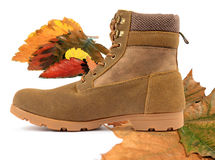 Autumn Days. Autumn leaves with boots isolated on a white background Royalty Free Stock Photos