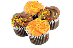 Autumn decorated chocolate cupcakes on white Stock Photography