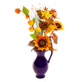 Autumn decoration. Decorative blue vase with sunflowers Royalty Free Stock Photos