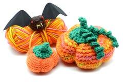 Autumn decoration crochet pumpkin and halloween bat of chestnut.  Royalty Free Stock Photography