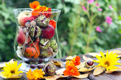 Autumn decoration. On the garden table Stock Photography