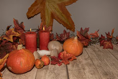 Autumn decoration with leafs, pumpkins and candles stock photos