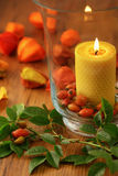 Autumn decoration of rose hips and candle Stock Photography