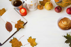 Autumn decorations with leaves, notebook, lantern, cup of tea, c Royalty Free Stock Photo