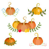 Autumn decorations. Small compositions with pumpkins, apples, leaves and berries. November harvest and Thanksgiving holidays theme design elements. Vector Stock Photo