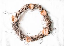 Autumn decorative vine wreath on a light background, top view. royalty free stock photo