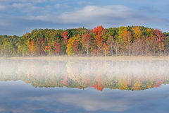 Autumn Deep Lake with Fog Stock Photo