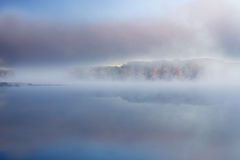 Autumn Deep Lake in Fog Stock Photography