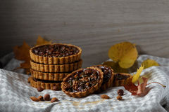 Autumn delicious cakes with nuts on plate. Royalty Free Stock Images