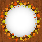 Autumn design frame, wreath of colorful maple leaves, window and autumn leaves over aged wooden background Stock Photo