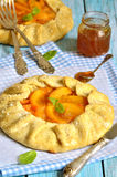 Autumn dessert - persimmon galette with apricot jam. Royalty Free Stock Photo