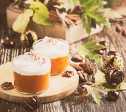 Autumn dessert of pumpkin mousse . Pastels Royalty Free Stock Image