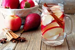 Autumn detox water with apple, cinnamon and pear Stock Photography
