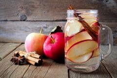 Autumn detox water in a mason jar on rustic wood Royalty Free Stock Photo