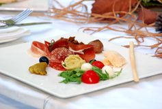 Autumn dinner. From meat and vegetables on plate Stock Photography