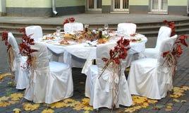 Autumn dinner. Served on table on the street Stock Photos