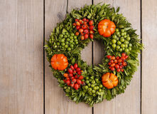 Autumn door wreath on wooden background. Copy space royalty free stock photography