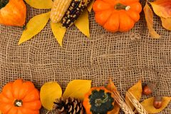 Autumn double border against a burlap background Royalty Free Stock Image