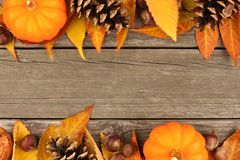Autumn double border on rustic wood Royalty Free Stock Photos
