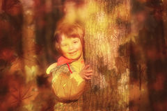 Autumn dream. Happy little girl playing in the autumn forest. Soft-focus, dreamy, abstract image Stock Photo