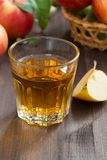 Autumn drink - apple cider or juice in a glass, vertical Stock Images