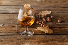 Autumn drinking time with alcohol glass Royalty Free Stock Image