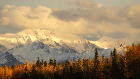 Autumn Drive Fall Colors Alaska Mountain Highway Transportation. The colors turn to red, yellow, and orange during the fall in south central Alaska stock video