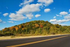 Autumn Driving. Rural road and landscape in autumn Royalty Free Stock Photos