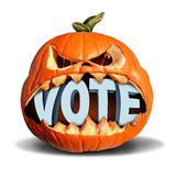 Autumn Election Vote. Symbol as a jack o lantern pumpkin biting into a 3D illustration of text as a presidential voting symbol or a seasonal fall  voter icon or Stock Image